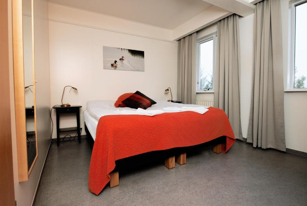 Cama ou camas em um quarto em Hotel Varmahlíd