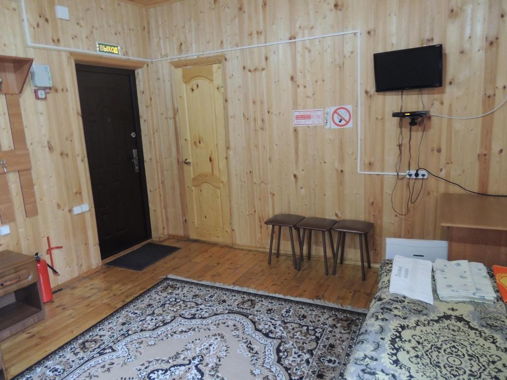 A television and/or entertainment center at Lesnaya Skazka Hotel