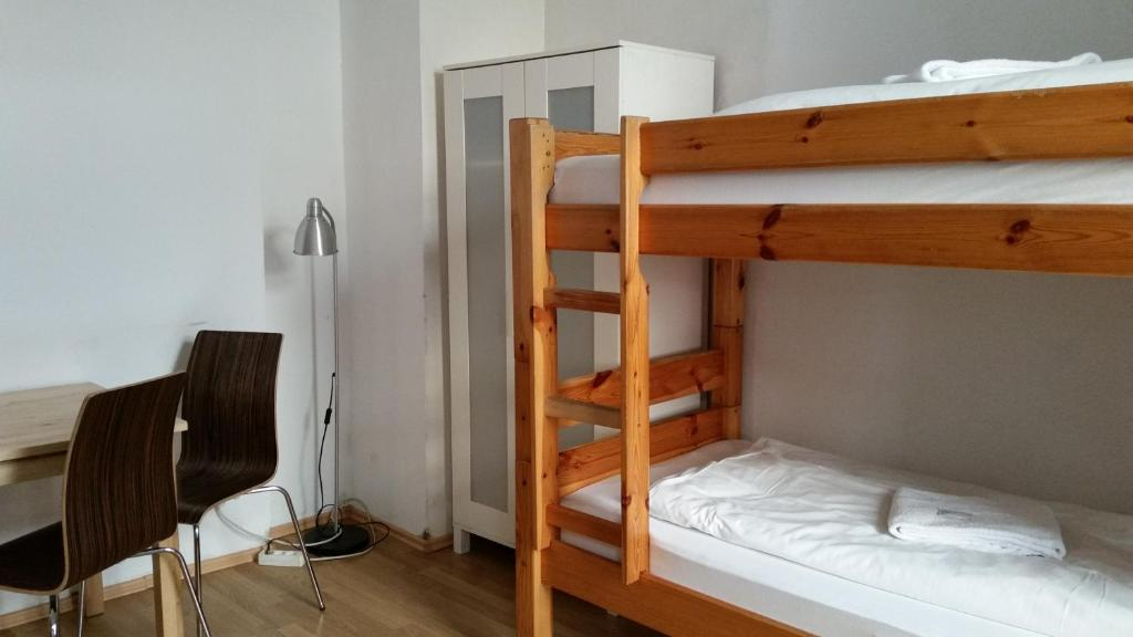 A bunk bed or bunk beds in a room at freiraum Hostel Kreuzberg