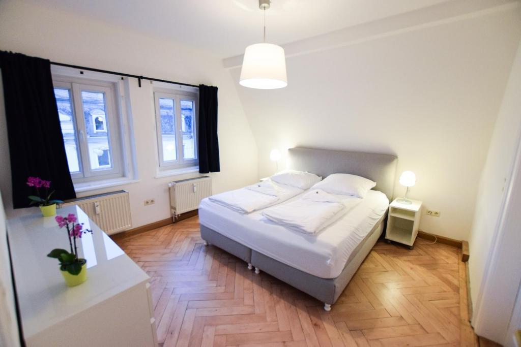 Ein Bett oder Betten in einem Zimmer der Unterkunft Ferienwohnung Ratisbona