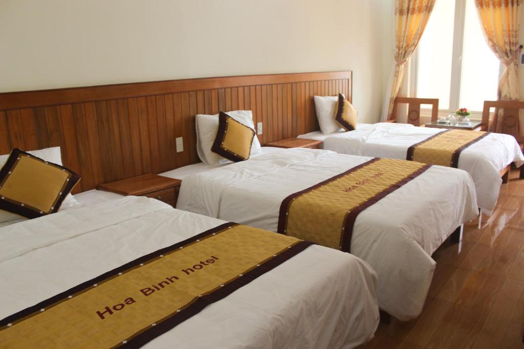 A bed or beds in a room at Hoa Binh Hotel