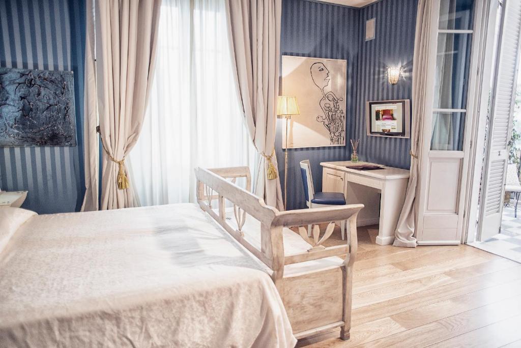 Letto o letti in una camera di Hotel Palazzo Guiscardo