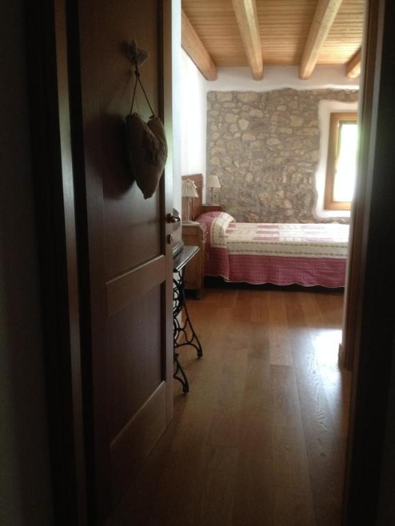 A bed or beds in a room at B&B Il Capriolo Felice