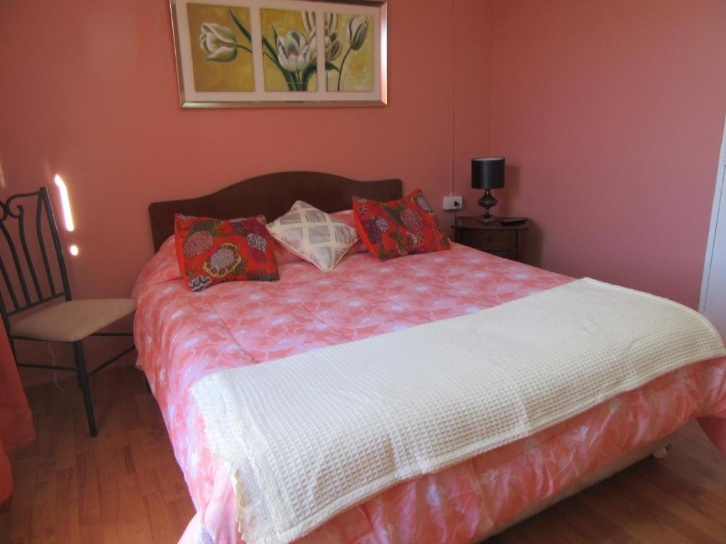Cama ou camas em um quarto em Apartamentos Norte Grande