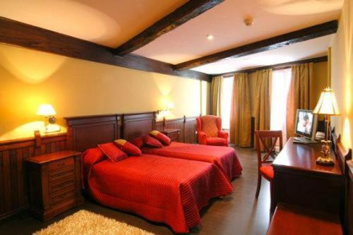 A bed or beds in a room at PR Santo Grial