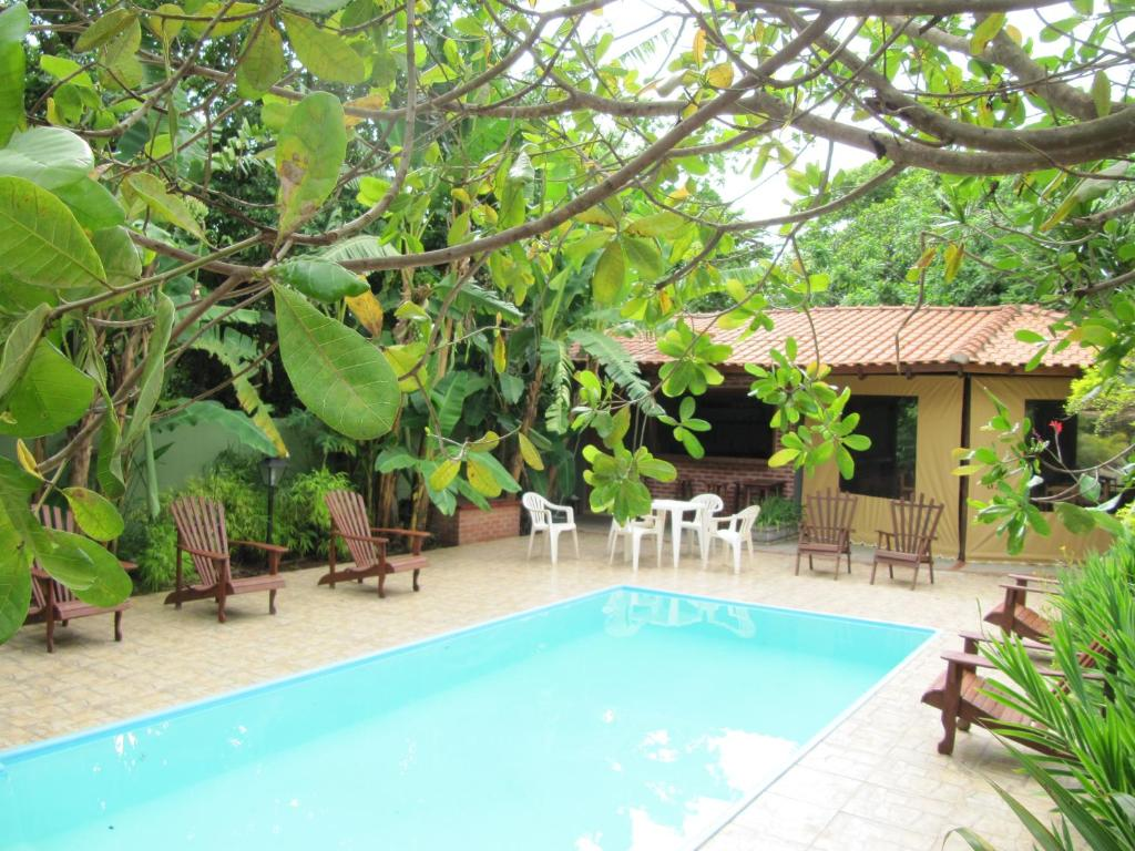The swimming pool at or near Eco Pousada Villa Verde