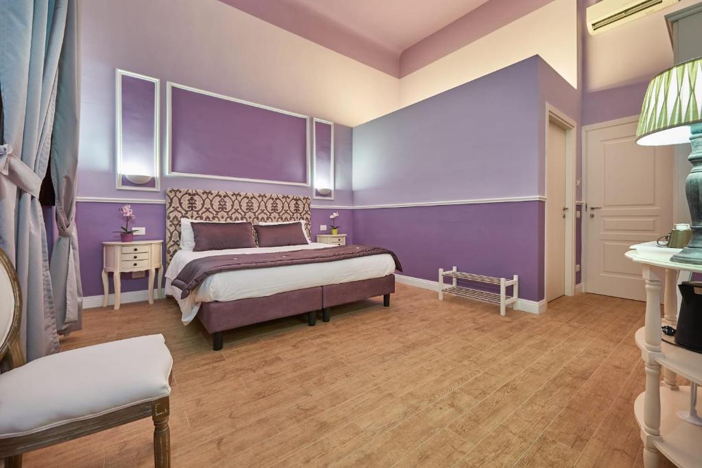 Een bed of bedden in een kamer bij B&B Le Stanze del Duomo