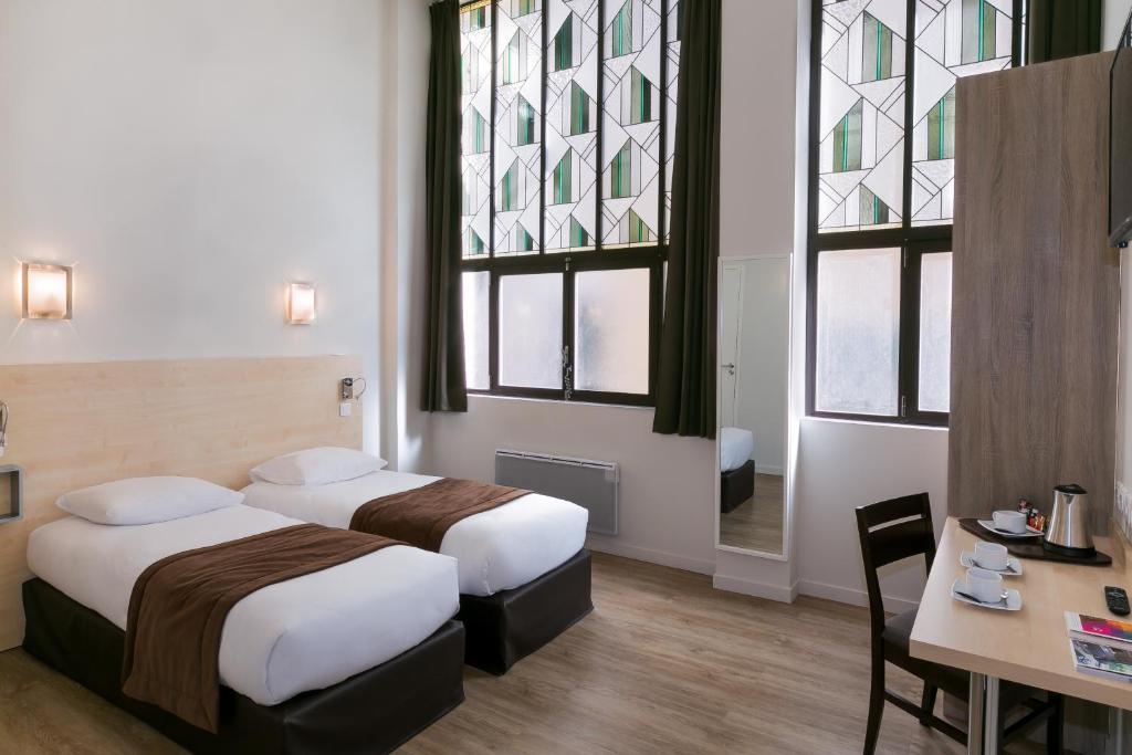 Un ou plusieurs lits dans un hébergement de l'établissement The Originals City, Hôtel Nancy Centre Gare (Qualys-Hotel)