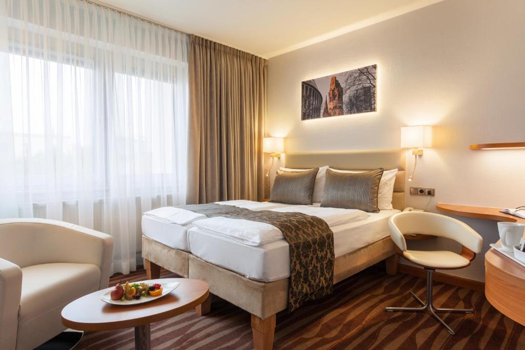 Ein Bett oder Betten in einem Zimmer der Unterkunft Golden Tulip Berlin Hotel Hamburg