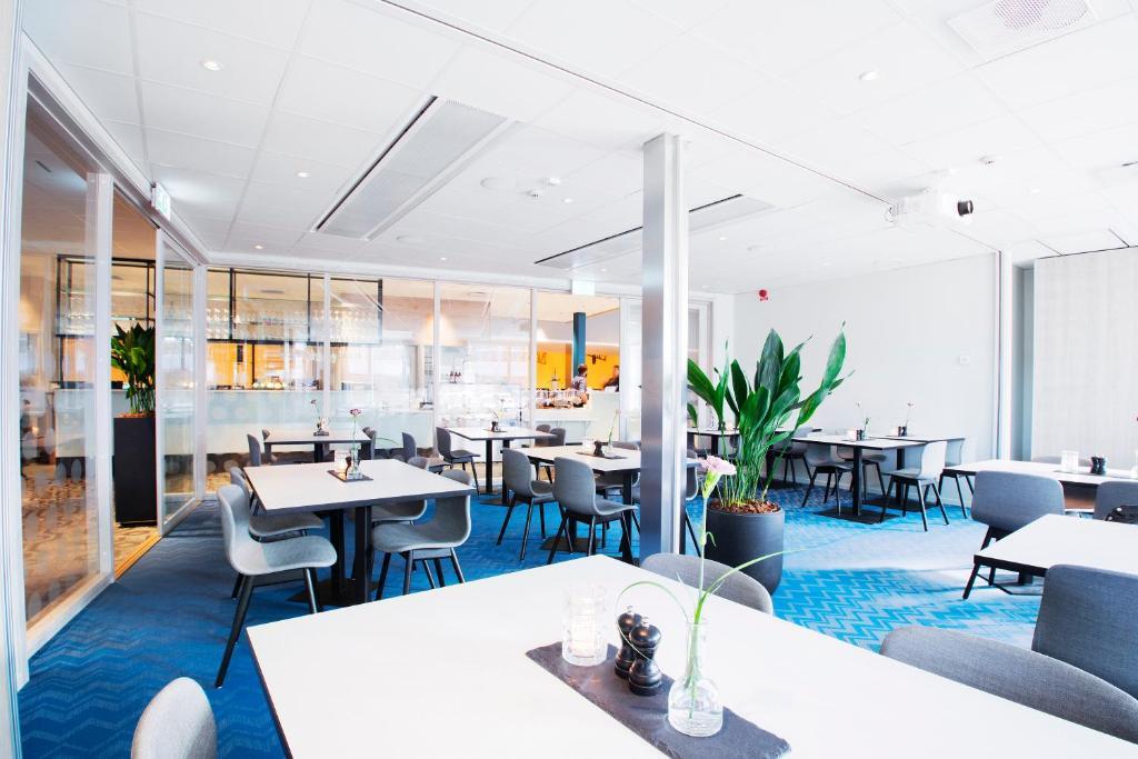 En restaurang eller annat matställe på RC Hotel Sport's & Business