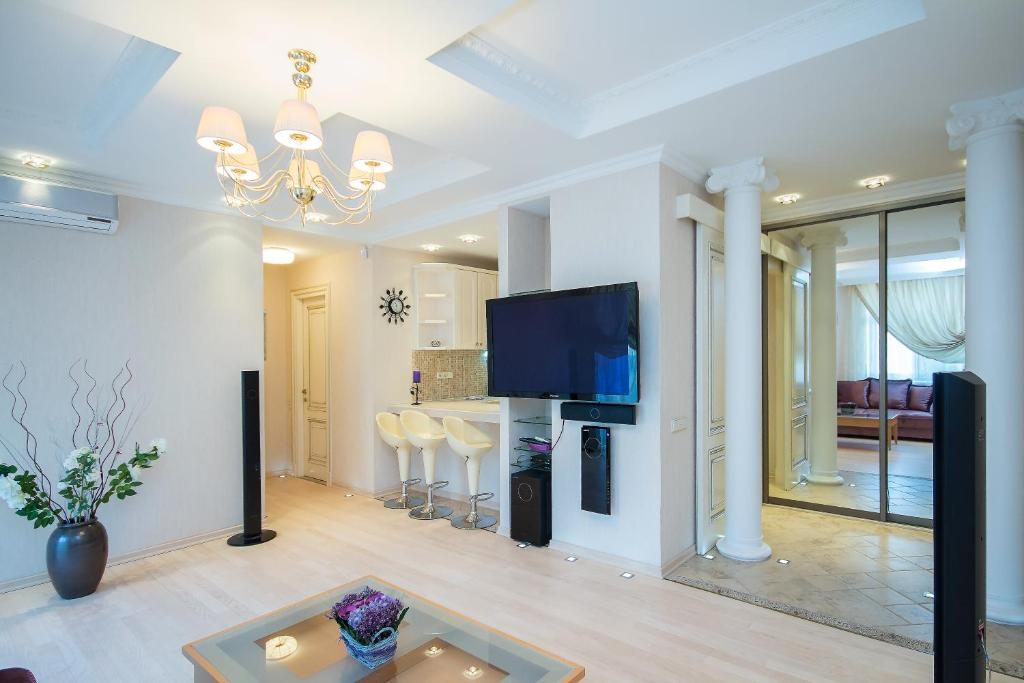 A television and/or entertainment center at Vip Apartment In Minsk