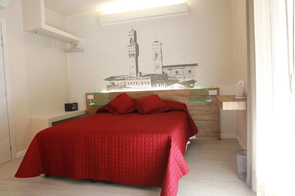 Letto o letti in una camera di B&B Santa Maria Novella