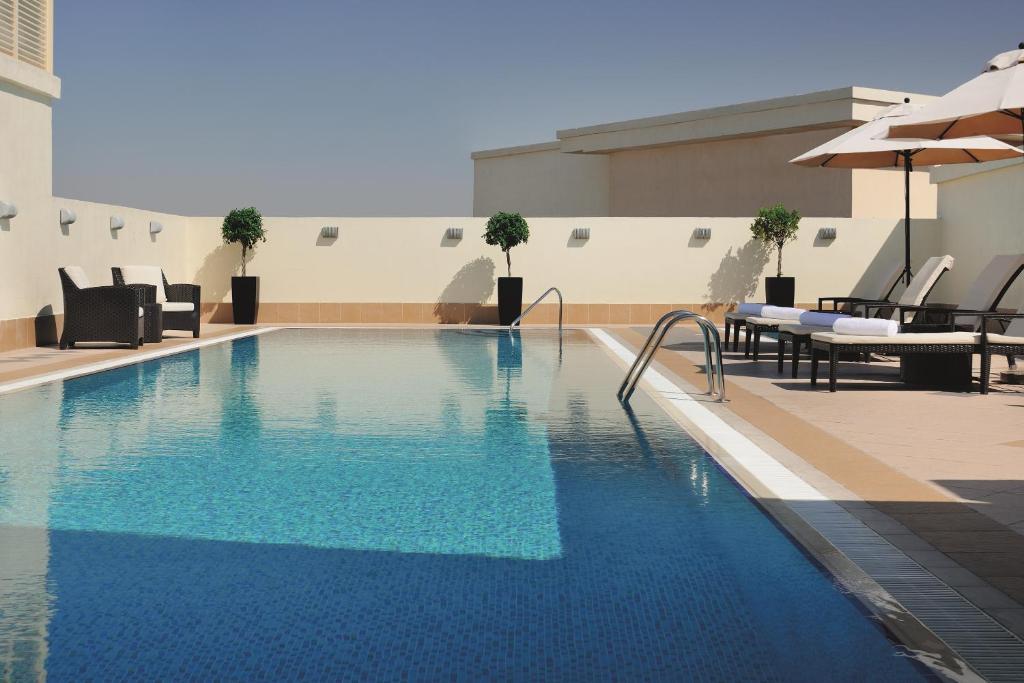 The swimming pool at or close to Avani Deira Dubai Hotel