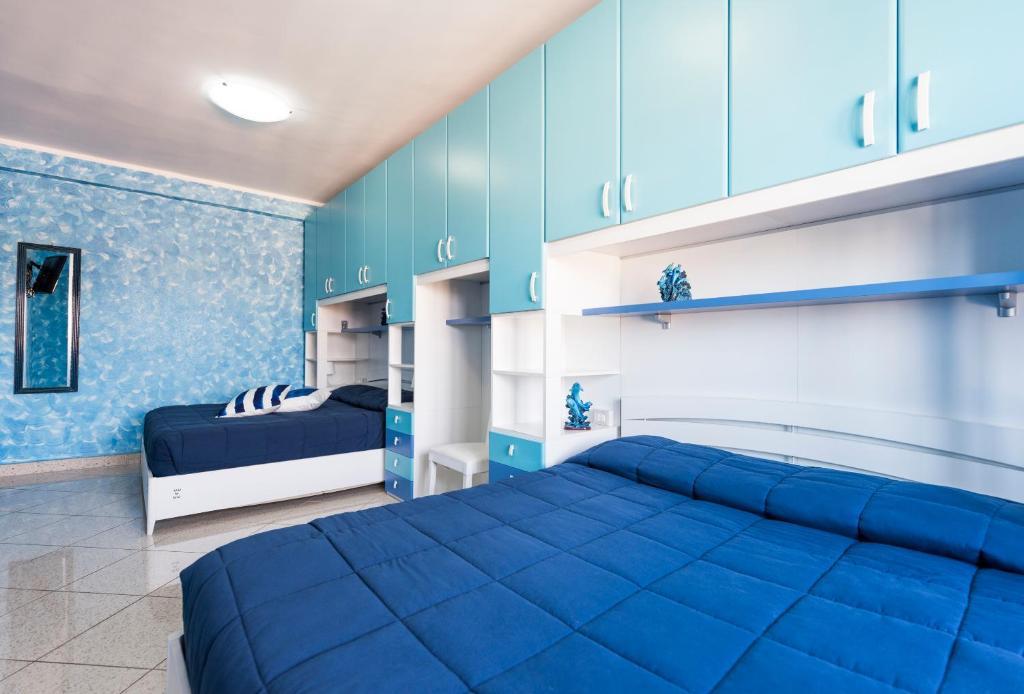 Letto o letti in una camera di Casa Vacanze Marco Aurelio