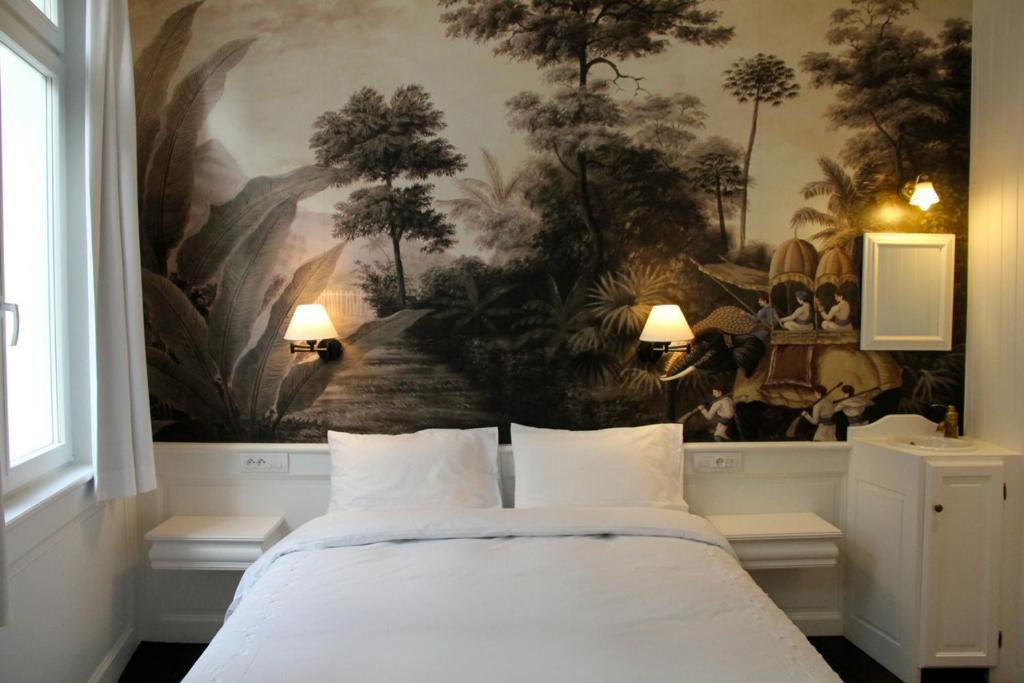 Cama ou camas em um quarto em L'Epicentre