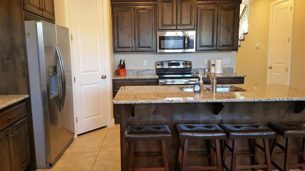 Escape to this beautiful 4 bedroom 3 bath St. George, Utah