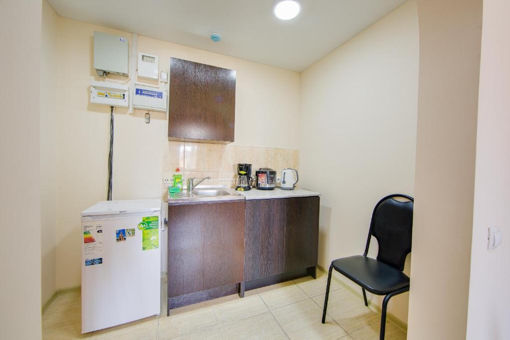 A kitchen or kitchenette at LETO hostel