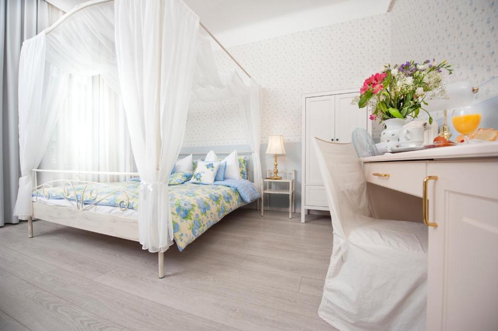 Ein Bett oder Betten in einem Zimmer der Unterkunft Boutique Hotel Kugel Wien