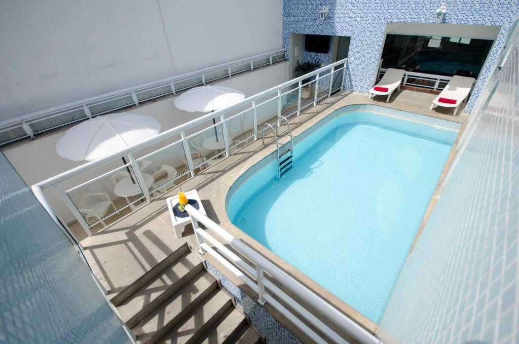 The swimming pool at or near Arcos Rio Palace Hotel