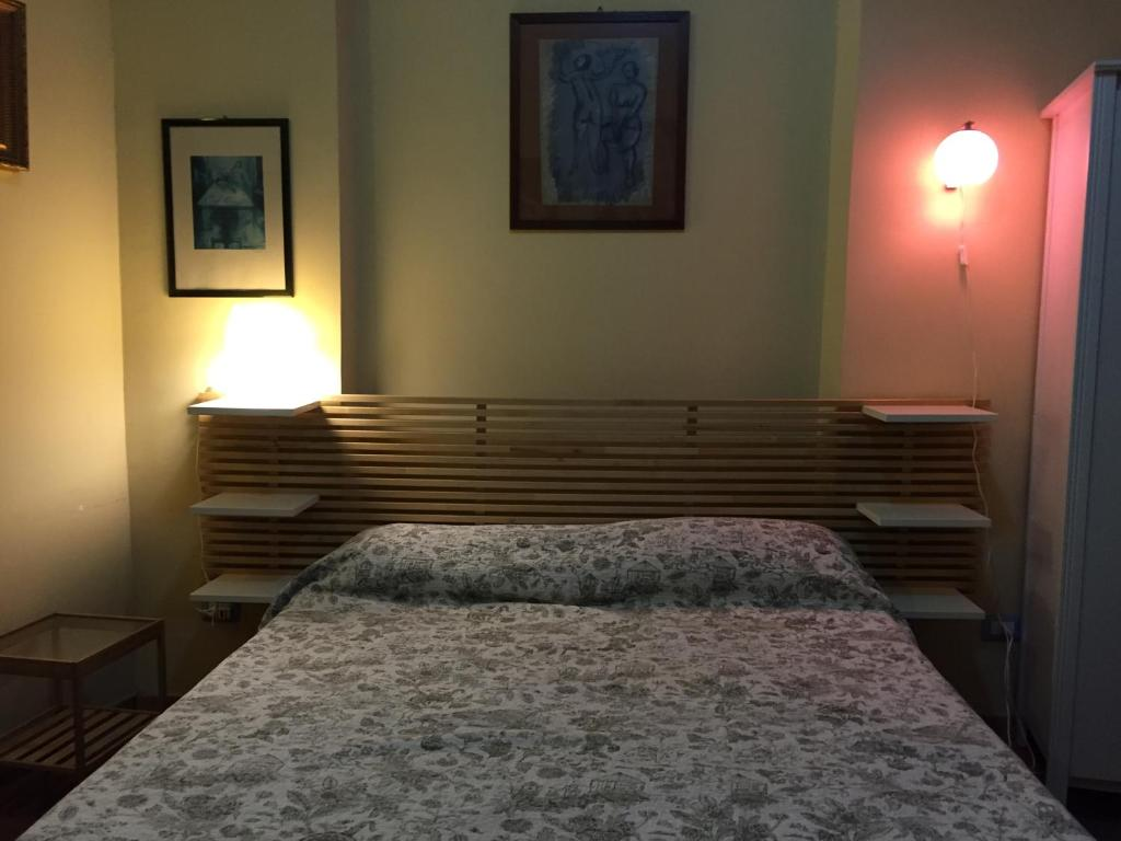 A bed or beds in a room at Residenza 53