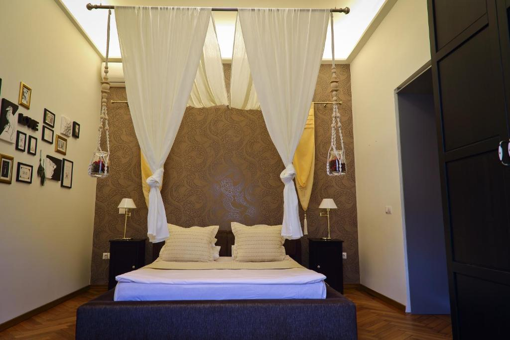 A bed or beds in a room at Arina Apartments 2