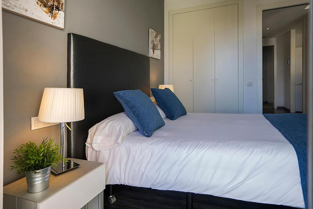 A bed or beds in a room at AB Parc Guell Luxury