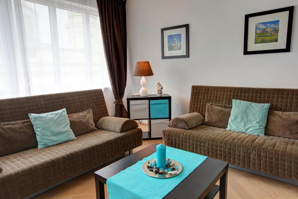 A seating area at Gasser Apartments - Apartments Karlskirche