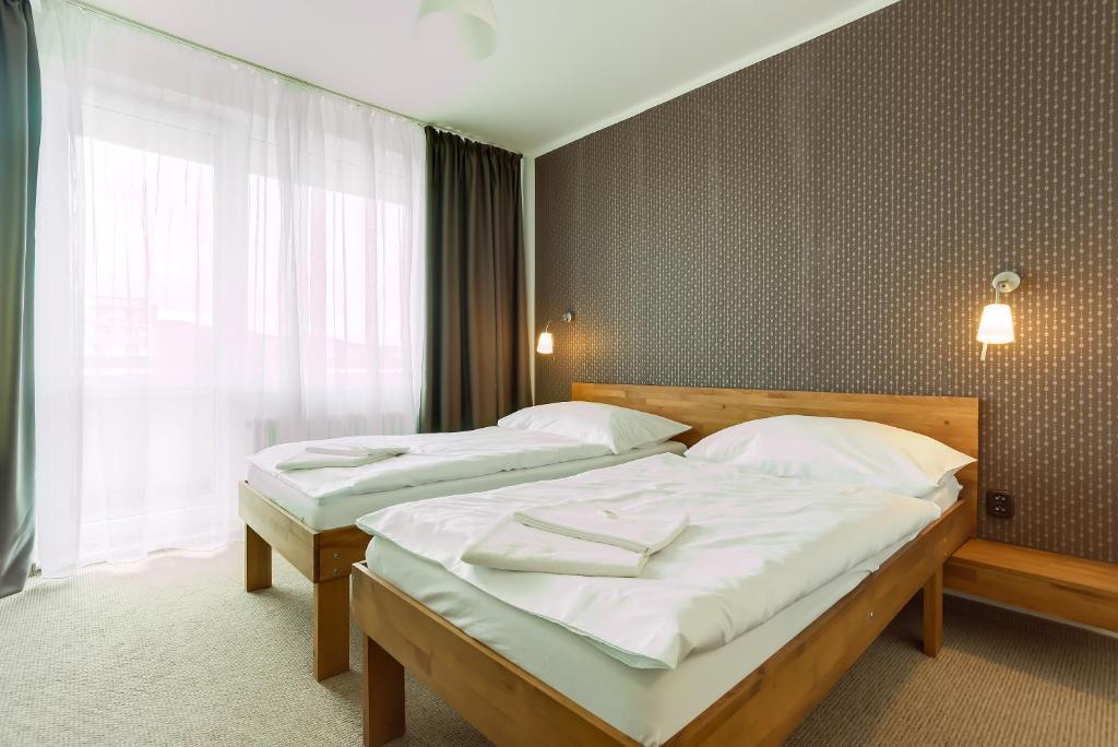 A bed or beds in a room at Hotel Lineas