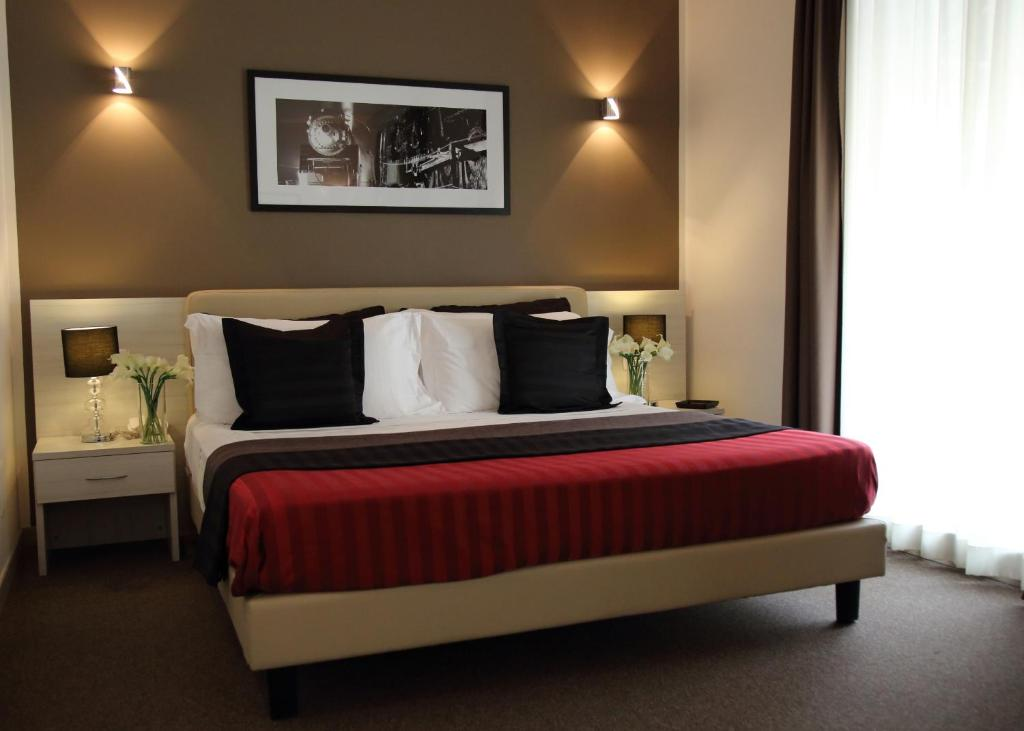 A bed or beds in a room at Stelle Hotel The Businest