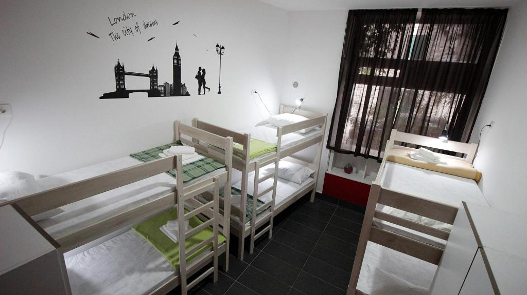 A bunk bed or bunk beds in a room at Hostel Like Me in Split