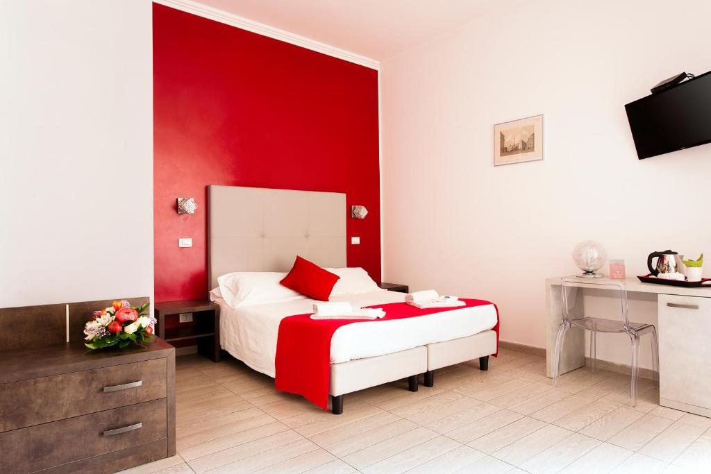 A bed or beds in a room at Le Terrazze di San Giovanni
