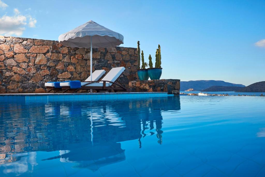 The swimming pool at or near Elounda Palm Hotel & Suites