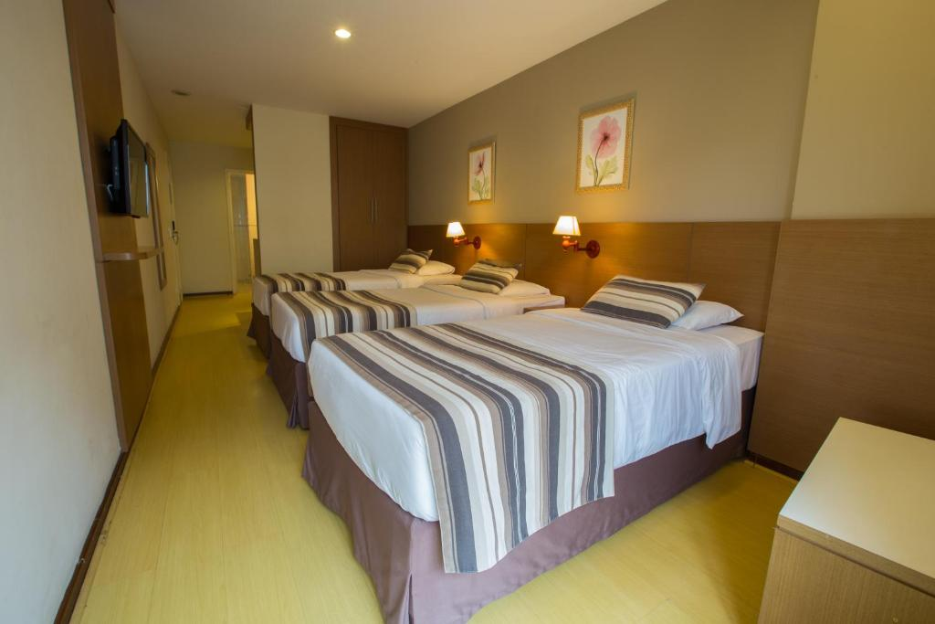 Cama o camas de una habitación en Augusto's Copacabana Hotel