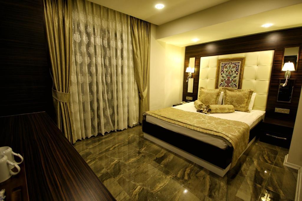 Кровать или кровати в номере Venus Suite Hotel