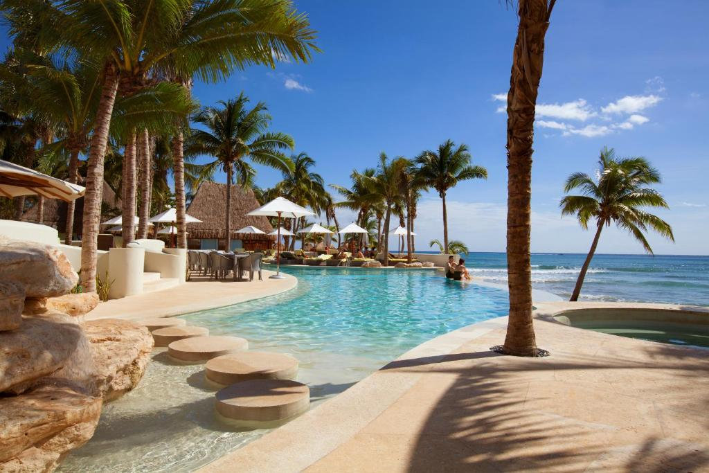 The swimming pool at or close to Mahekal Beach Front Resort & Spa