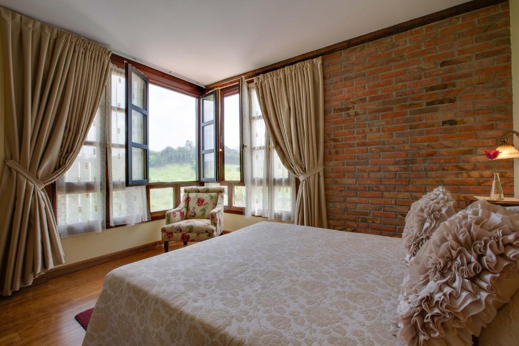 Cama o camas de una habitación en La Casona de la Roza