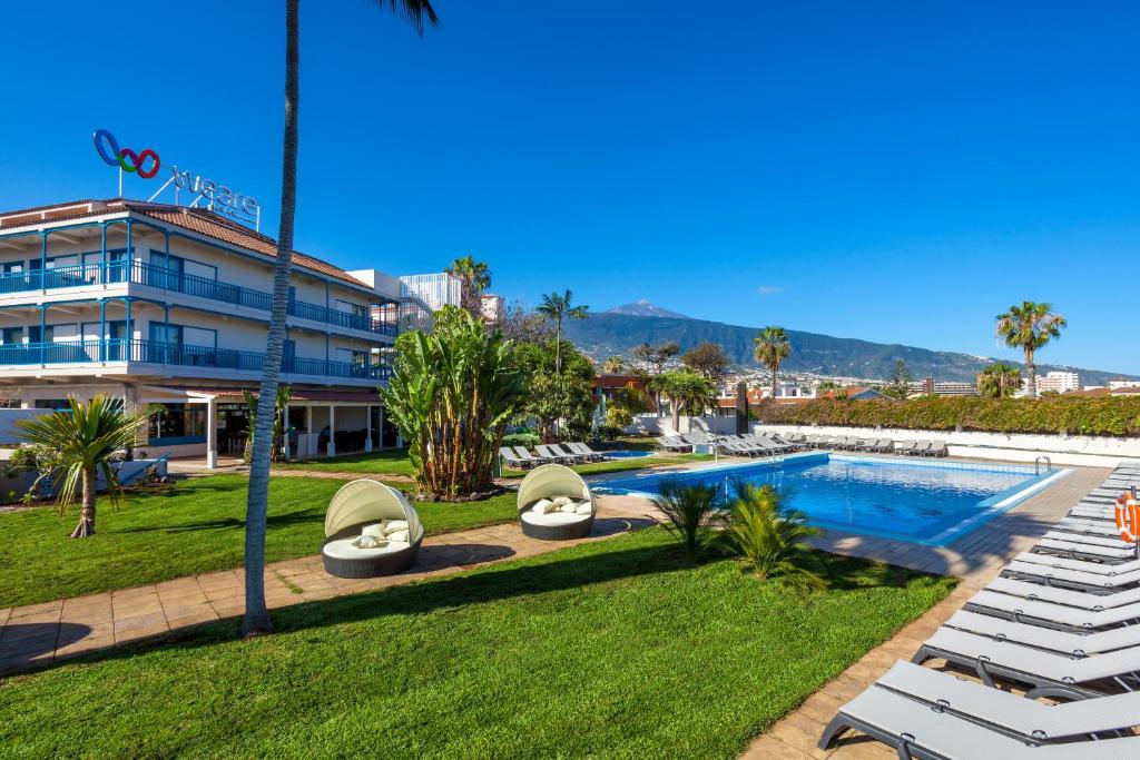 A view of the pool at Hotel Weare La Paz or nearby