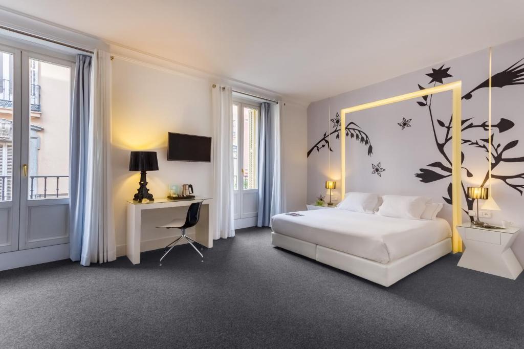Cama ou camas em um quarto em Room Mate Mario