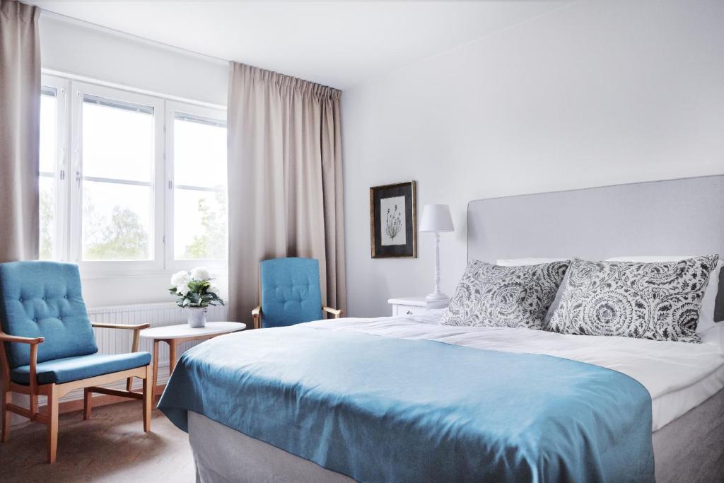 Säng eller sängar i ett rum på Hotell Danderyds Gästeri
