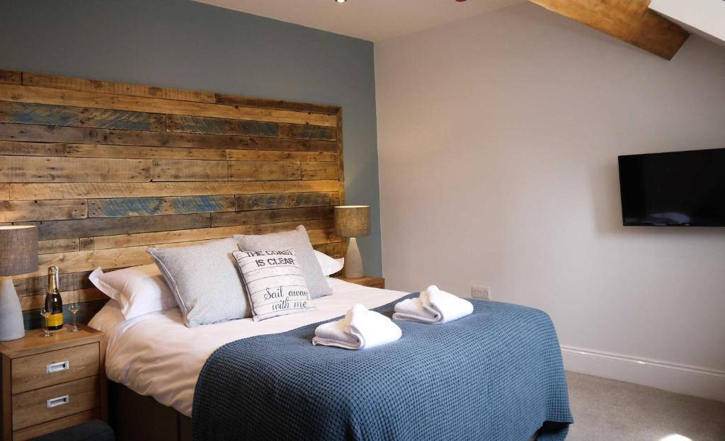 A bed or beds in a room at The Belfry Whitby