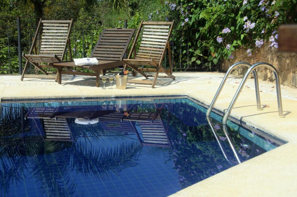 The swimming pool at or near Pousada Araujo Bazilio