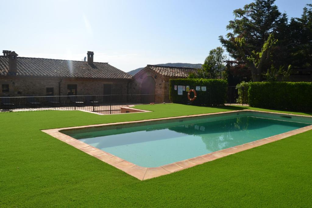The swimming pool at or near Mas Roselló-Adults Only