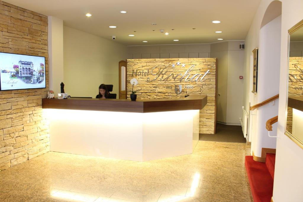The lobby or reception area at Hotel Rochat