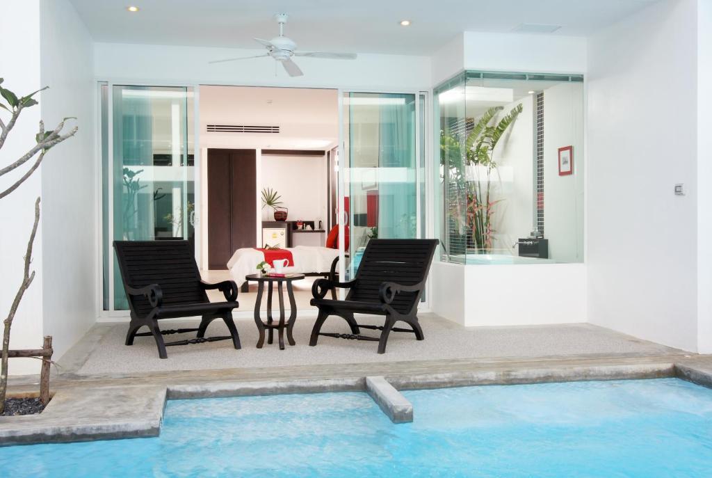 Патио или другая зона на открытом воздухе в The Old Phuket - Karon Beach Resort