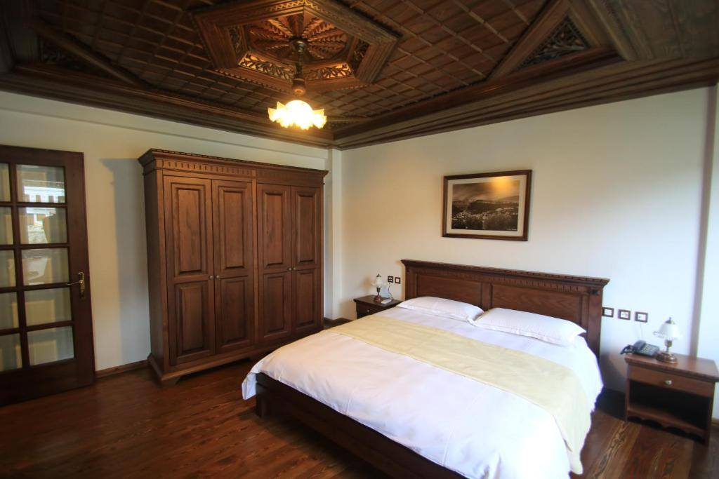 A bed or beds in a room at Boutique Hotel Muzaka (Historic Center)
