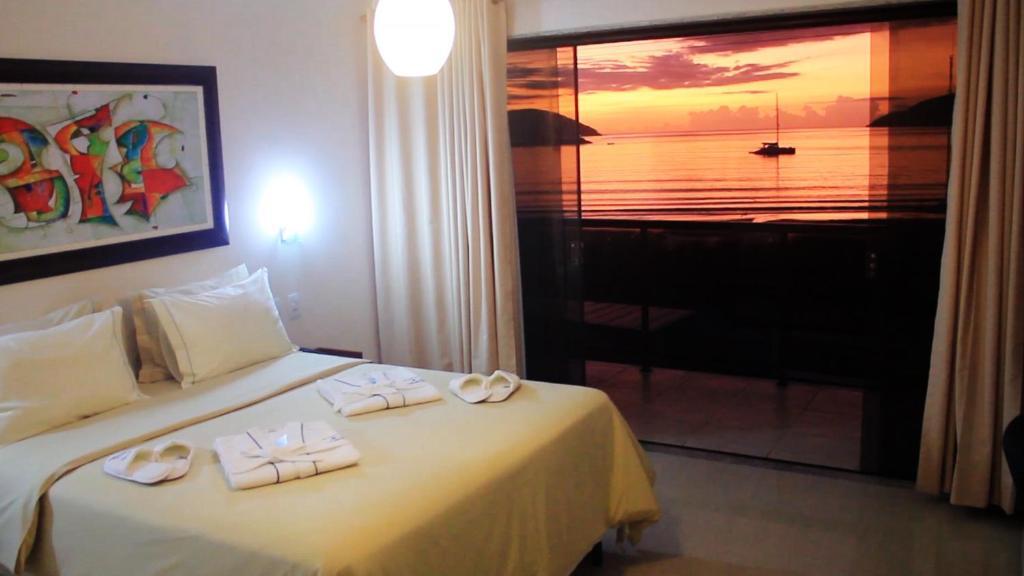 Cama ou camas em um quarto em Pousada Canto da Baleia