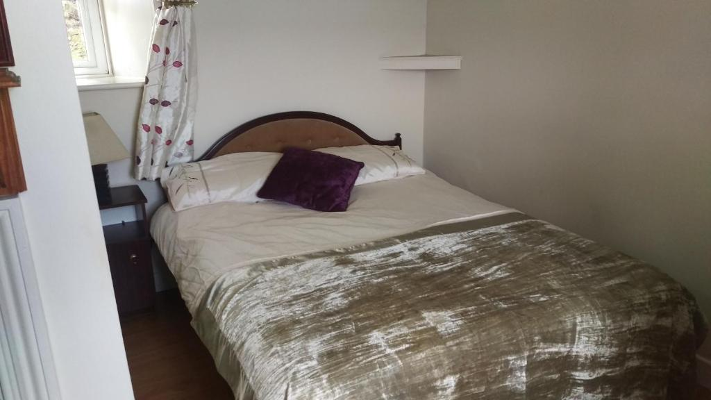 A bed or beds in a room at The Owl House