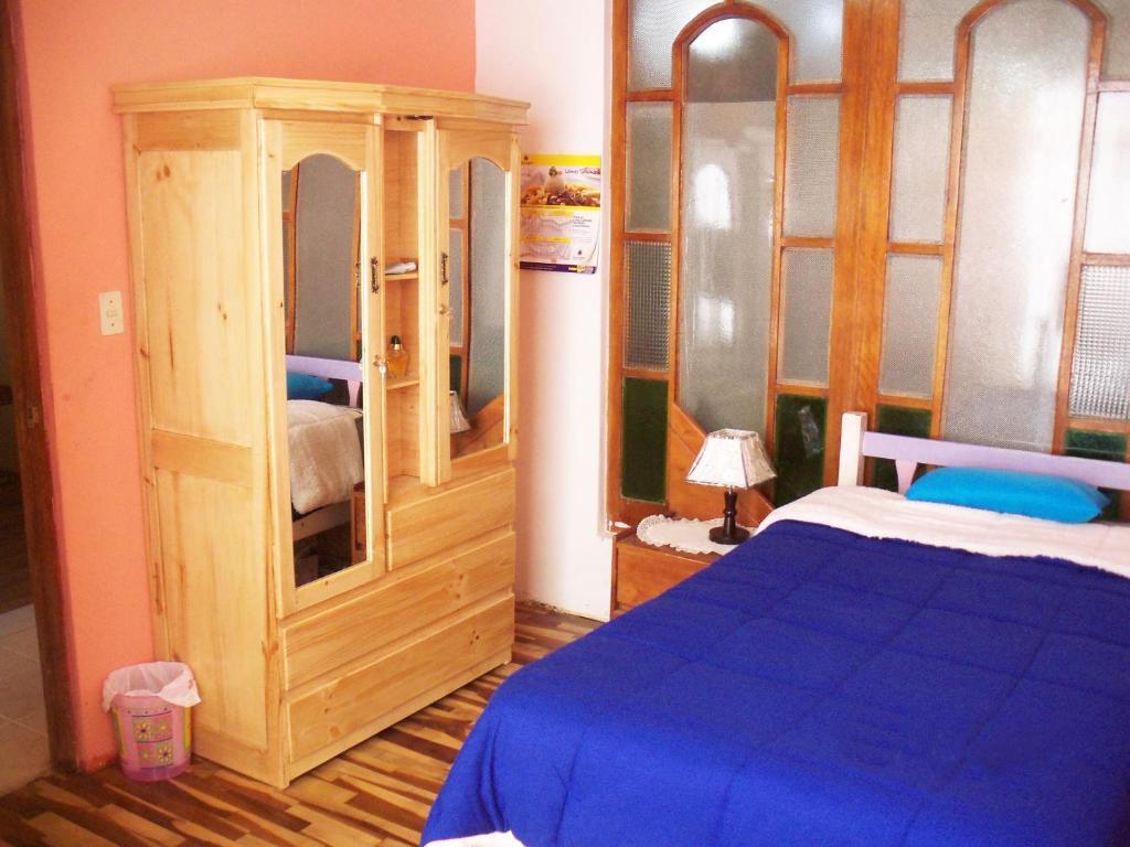 Cama o camas de una habitación en Apart Cusco Colibry Kennedy B