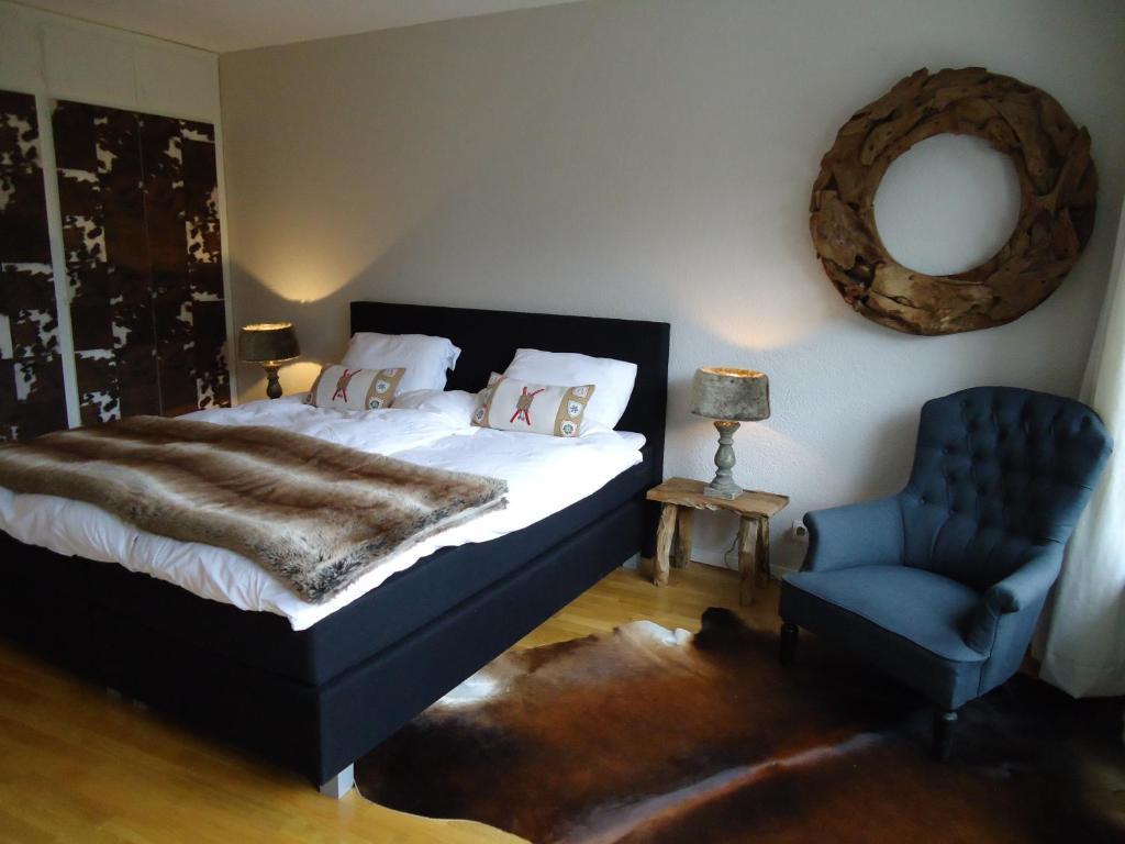 Un ou plusieurs lits dans un hébergement de l'établissement Design - Appartement - Crans