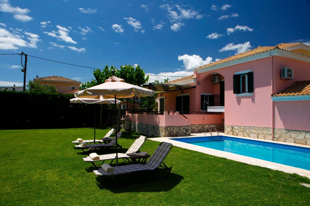 A garden outside Anthemis Luxury Villas
